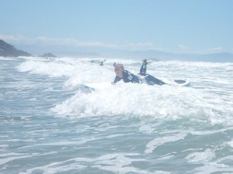 Surfing at Sumner Beach, NZ